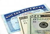 pic of social-security  - stock pictures of a social security card and money - JPG