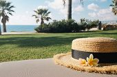 Straw Hat With Flowers On A Beach Lounge Chair.tropical Summer Vacation Concept. Happy Sunny Day On  poster