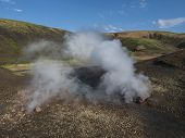 Hot Spring With Boiling Water Rising From Rocks In Landmannalaugar Colorful Rhyolit Mountains On Fam poster