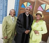 stock photo of piety  - Portrait of senior African American couple and Reverend - JPG