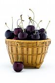Sweet Black Cherries In A Wood Basket