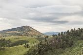 hiking trail in Horsetooth Mountain Park, residential houses and Rocky Mountains, Fort Collins, Colorado - springtime scenery