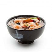 Japanese Cuisine - Suimono Soup made of Fish, Pork, Mushrooms, Shrimps and Noodles (Udon). Garnished