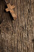 pic of rosary  - the antigue wooden cross on old wooden background - JPG