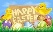 stock photo of ester  - Drawing of an Easter sign reading Happy Easter surrounded by Easter eggs and yellow cartoon Easter chicks - JPG