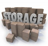 The word Storage in the middle of a stockpile of many piles of cardboard boxes to represent storing your old belongings and valuables in a locker, basement or other store room.
