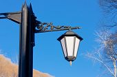 stock photo of perm  - lantern on a background blue sky in a winter park city Perm Russia - JPG