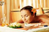 foto of sauna woman  - Beautiful young woman taking spa treatments at the salon - JPG