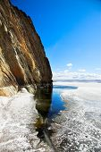 cliffs at frozen baikal lake in winter