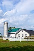 stock photo of barn house  - farm house with field and silo in beautiful landscape - JPG
