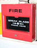 stock photo of fire brigade  - An industrial break glass here red fire alarm which is connected to the fire brigade - JPG