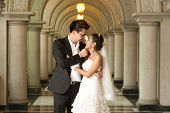 A Beautiful Bride And Handsome Groom At Christian Church During Wedding .