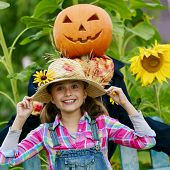 foto of scarecrow  - Scarecrow and happy girl  in the garden  - JPG