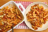 Baked penne pasta gratin with tuna fish.