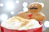 image of ginger man  - Gingerbread cookie men in a hot cup of cappuccino - JPG