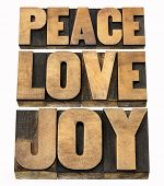 peace, love and joy word abstract - a collage of isolated text in letterpress wood type