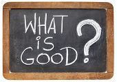 what is good question - ethical concept - white chalk handwriting on a vintage slate blackboard