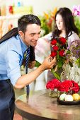 Young Asian or Indonesian Man is interested for a bouquet Roses