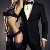 stock photo of fine art portrait  - Art photo of a young couple in sensual lingerie and a tuxedo - JPG