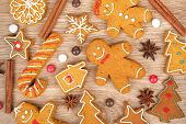 picture of ginger man  - Homemade various christmas gingerbread cookies on wooden background - JPG