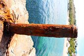 Rusty mooring capstan on a pier