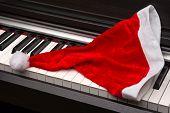 Piano key with santa hat .