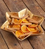 stock photo of centerpiece  - Centerpiece Christmas star shaped with orange slices and cinnamon - JPG