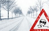 stock photo of icy road  - Sudden and heavy snowfall on a country road - JPG