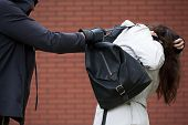 pic of dangerous situation  - Dangerous masked man is assaulting a student to steal a backpack - JPG