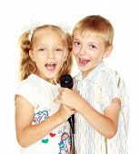Girl and boy are kept in the hands of a microphone insulated