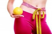 Time For Diet Slimming. Woman Tape Around Body Fruit In Hand