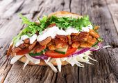 Pita bread and Kebab meat on wooden background