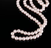 Beautiful pearls on black background