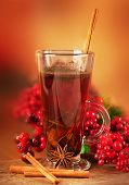 Mulled wine from wine and cinnamon, a Christmas branch of berries
