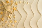 Starfish On Golden Beach Sand With Wavy Lines