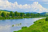 Spring Landscape With The Tatra Mountains Over The Dunajec River.