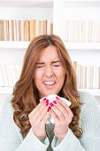 Sick Woman Sniffles With Virus Feeling Ill Sneezing Into Tissue