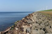 pic of dike  - Dutch dike along the sea with wind turbines - JPG