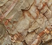 stock photo of cleaving  - background or texture cleaved sandstone block gray and terracotta color - JPG