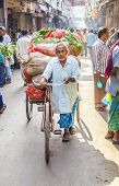 Rickshaw Rider Transports Vegetables Early Morning At The Market