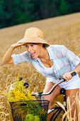 pic of riding-crop  - Girl rides bicycle in rye field - JPG
