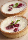 stock photo of torte  - Delicious raspberry and custard tart decorated with fresh mint - JPG