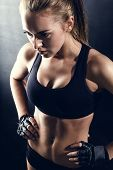 picture of abs  - attractive fitness woman listening to music at her smartphone - JPG