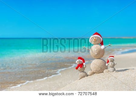 Snowmans Family At Sea Beach In Santa Hat. New Years And Christm poster