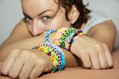 Young Caucasian Woman With Colorful Rubber Bracelets On Her Hands
