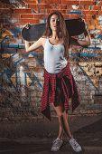 teen girl with skate board
