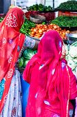 Indian Women Buying Colorful Bangles At Market Place