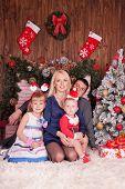 Happy Family Near Decorated Chtistmas Tree