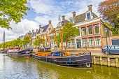 stock photo of pontoon boat  - old boats in a canal in Harlingen - JPG