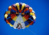 stock photo of parasailing  - Parasailing over the blue sky - JPG